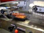 Горизонтально упаковочн. машина для упаковки творога, слив. масла, колбасы