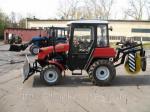 Трактор «Беларус 320.4» уборочно-подметальный КМ320БГ со щеткой и отвалом